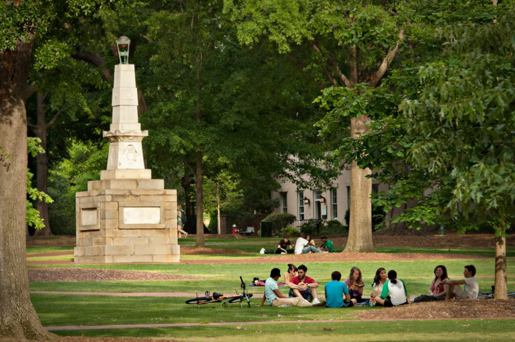 Students relaxing and having fun on the historic Horseshoe at the University of South Carolina.