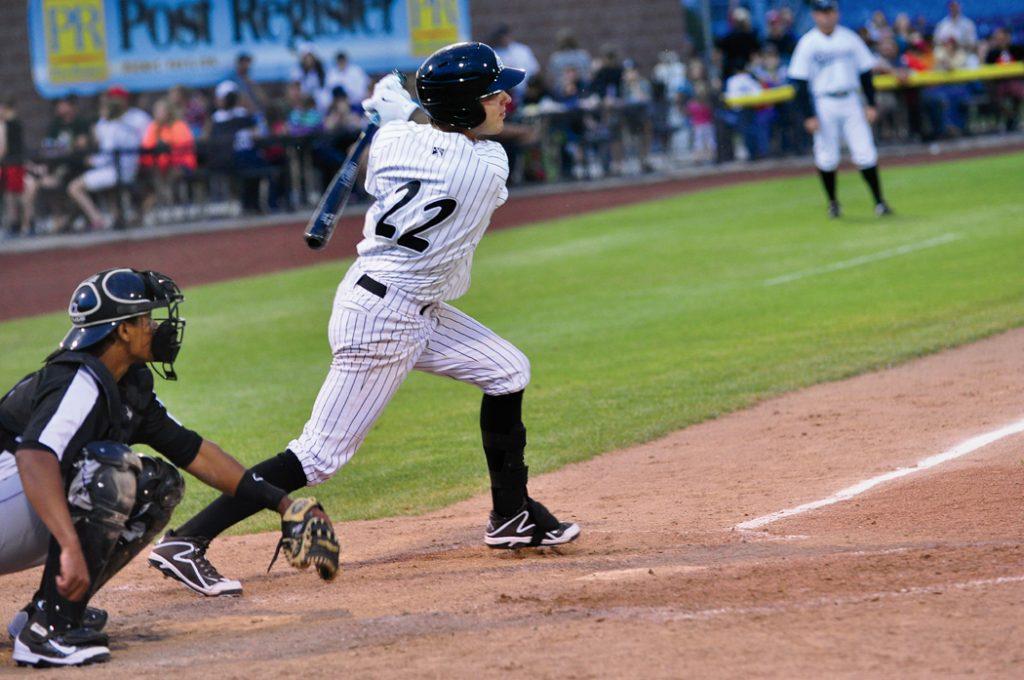 Ryan Dale of the Idaho Falls Chukars hits a ball during a game.