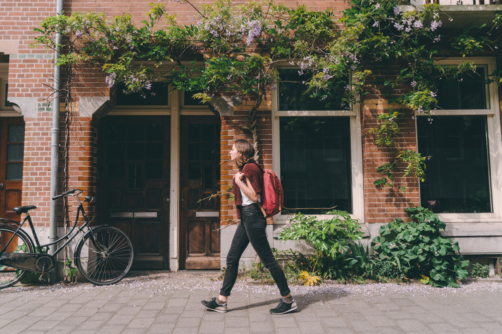 woman walking through a new city