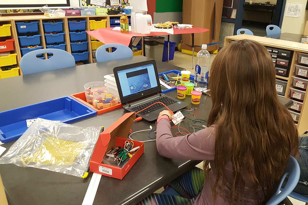 Girl on computer in classroom